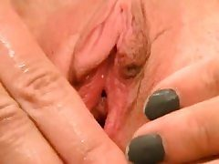Softcore girl is wide open humid slit in closeup and having climax