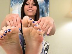 Foot taunting she-male touching her soles with grease