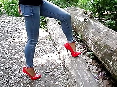 Extreme heels and jeans, my killer legs,walk in the woods