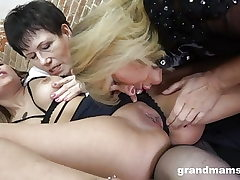 2 lesbian grandmas share double faux-cock and munch young slit
