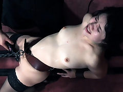 Submissive petite beauty gagged and played