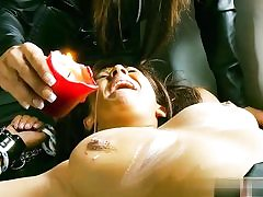 Super hot bitch in leather costume abusing a naked couple running in rivulets paraffin wax on their jizz-shotguns