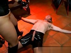 Crazy bitch wearing ultra-kinky latex and gives this salami a handjob