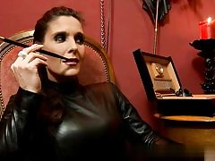 Mischievous whore dressed in all leather on porn movie smoking a cigarette